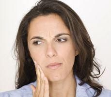 A woman with a painful toothache
